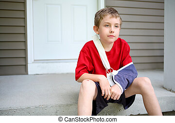Boy with arm in a sling