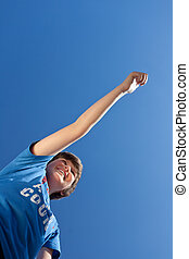 Boy With Arms Raised Celebrating Victory Against Blue Sky
