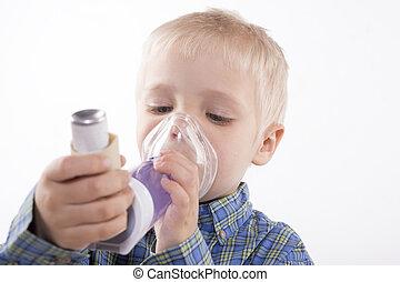 boy with asthma inhaler