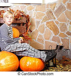 Boy with autumn pumpkin