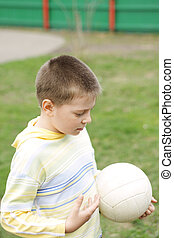 Boy with ball in hand