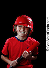 Boy with baseball bat on black background