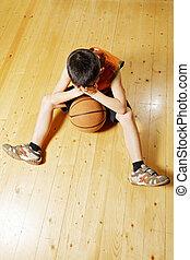 Boy with basketball on floor