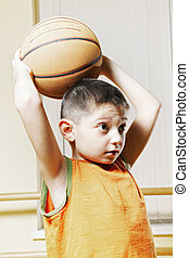 Boy with basketball over head