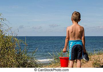 Boy with beach toys