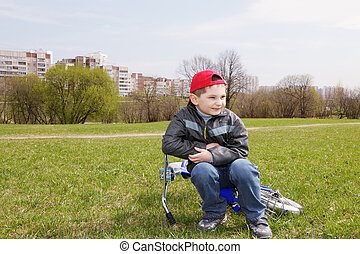 Boy with bicycle in park