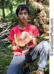 Boy with big mushroom