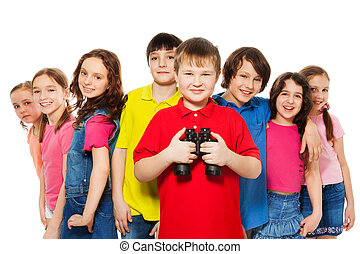 Boy with binoculars in a group