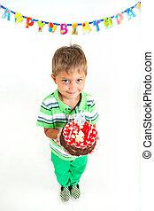Boy with birthday cake