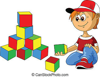 boy with blocks - little boy playing with multicolored cubes...
