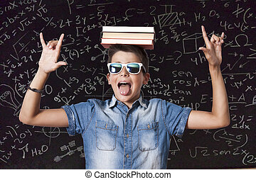boy with books on head