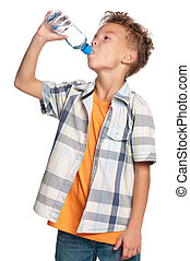 Boy with bottle of water - Happy boy drinks water from a...