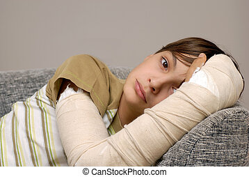 Boy with broken arm - sad teenage caucasian boy with broken...