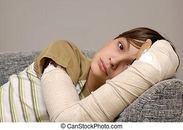 Boy with broken arm - sad teenage caucasian boy with broken...