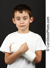 Boy with broken hand in cast