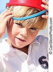 Boy with bucket on head