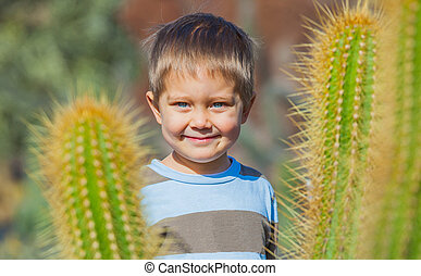 Boy with cactus