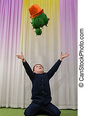 Boy with cactus - Little boy hugs a toy cactus of his ...