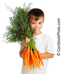 Boy with carrots - Boy eating fresh carrots isolated on...