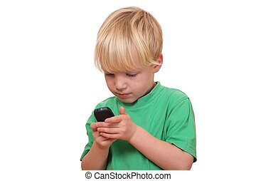 Boy with cell phone - Portrait of a young boy playing with ...
