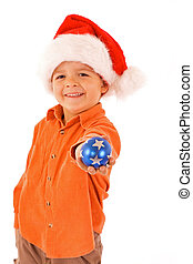 Boy with christmas bauble and santa hat - isolated