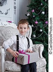 Boy with Christmas gift-box