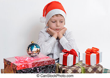boy with christmas present boxes