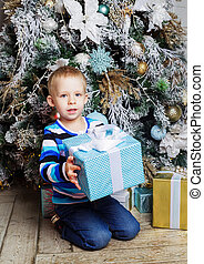 boy with Christmas tree