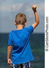 Boy with clenched fist
