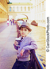 boy with coffee - smiling stylish boy with coffee in the...