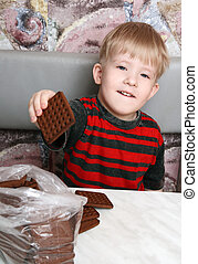 Boy with cookies in hand - Sly child reaches for the pack of...