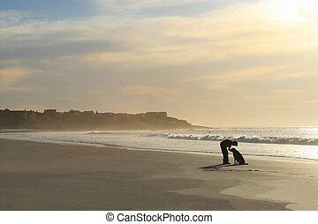 Boy with dog on beach