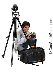 Boy with equipment of photographer