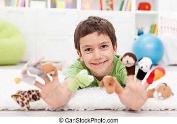 Boy with finger puppets playing on the floor