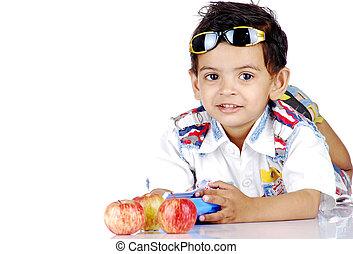 boy with fresh apples lying on floor