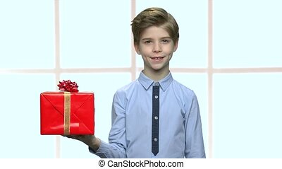 Boy with gift box on his palm.