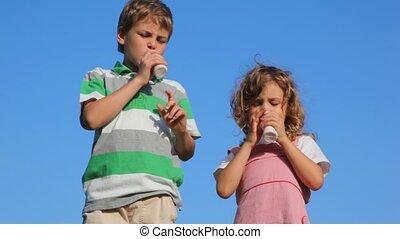 boy with girl drink yoghurt