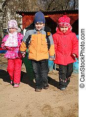 boy with girls in kindergarten