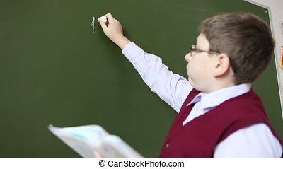 boy with glasses decides to sample at the blackboard HD