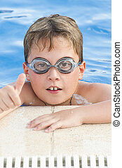 Boy with glasses enjoying the summer pool