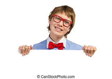 boy with glasses holding a white placard