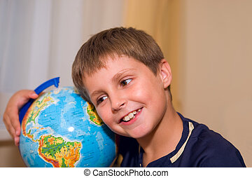 boy with globe of world