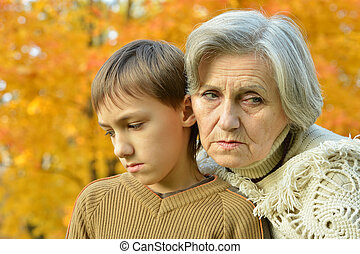 boy with grandmother in park