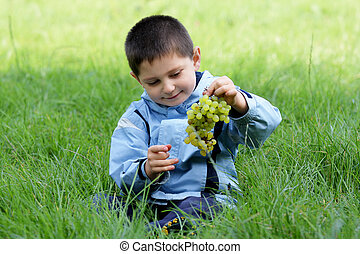 Boy with grapes