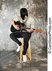 Boy with guitar.