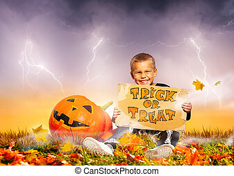 Boy with Halloween tick or treat cardboard sign