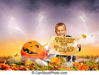 Boy with Halloween tick or treat cardboard sign
