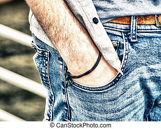 Boy with hand in jeans pocket