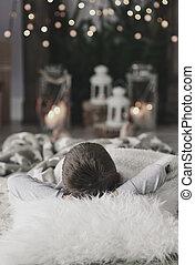 Boy with hands behind head lying on floor