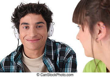 boy with headphones and girl